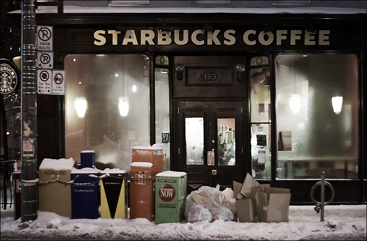 Starbucks store with newspaper boxes