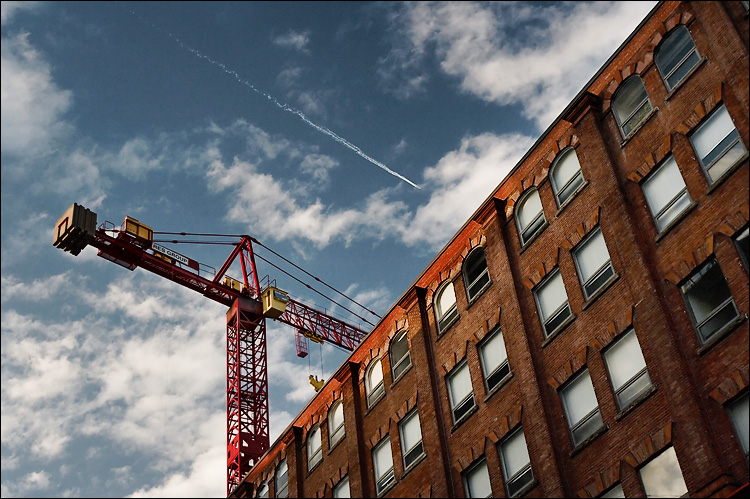 bricks, crane and jet || canon350d/ef17-40L@30 | 1/100s | f7.1 | ISO400 | handheld