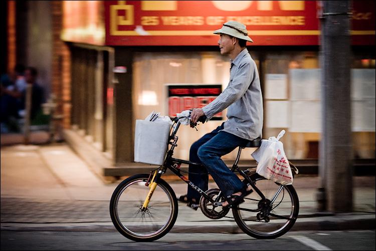 biker on red || SonyA700/Zeiss135 | 1/60s | f2 | ISO800 | Handheld