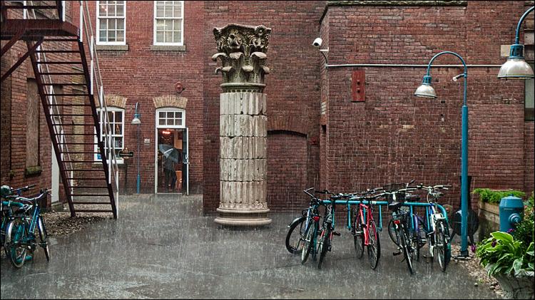 rain, bikes and the column || Panasonic LX3 | 1/40s | f2.8 | ISO400