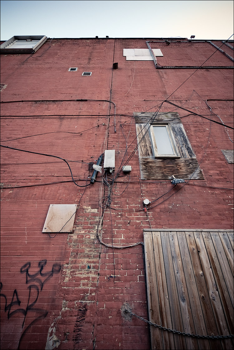 cables and brick wall || PanasonicGF1/Vario7-14@7 | 1/40s | f4.5 | ISO100