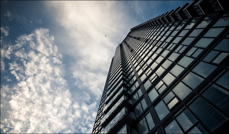 glass, clouds and plane || Panasonic GF1/Vario7-14@9 | 1/160s | f5 | ISO100