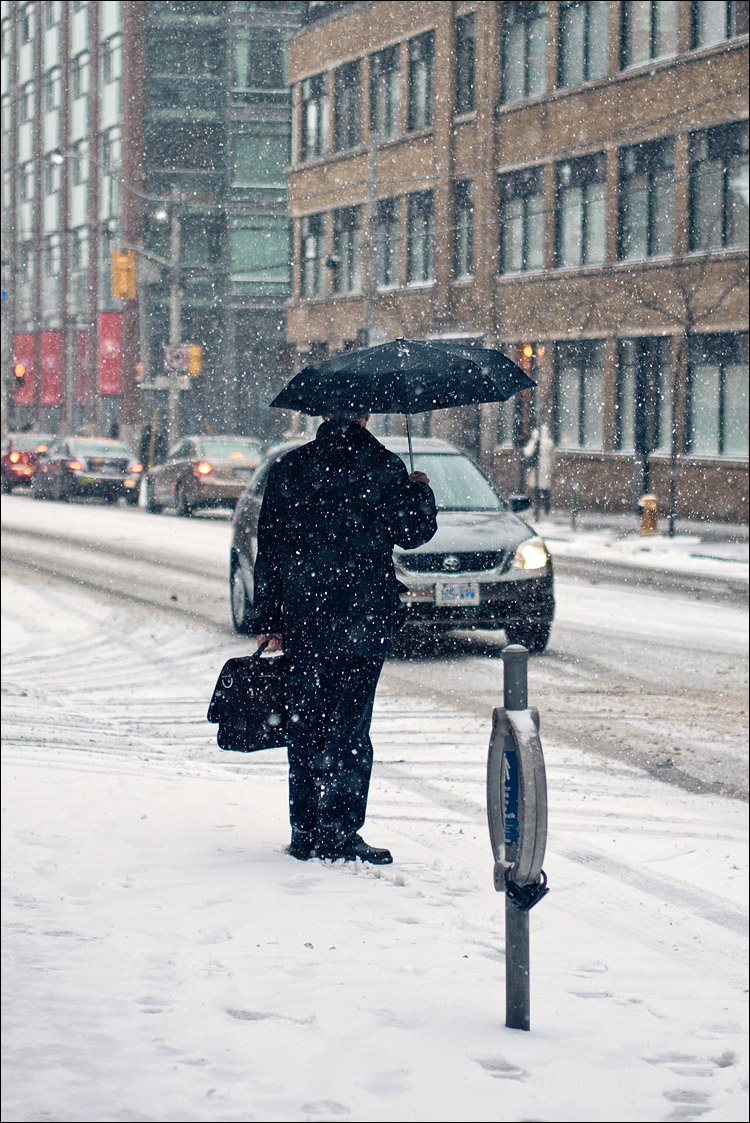 Umbrella Man in Snow || Panasonic GF1/Olympus45f1.8 | 1/320s | f1.8 | ISO100