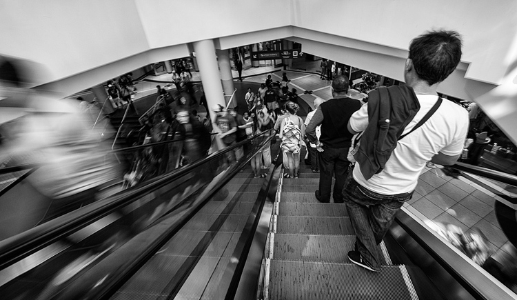 People on Escalator || Panasonic GX1/Lumix7-14@7 | 1/5s | f8 | ISO160