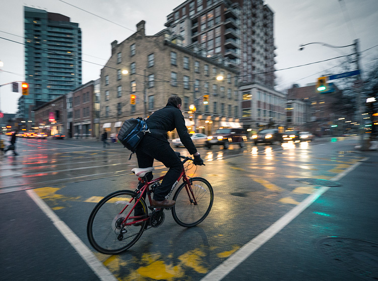 Cyclist in Rain || Panasonic GH3/Lumix7-14@7 | 1/60s | f4 | ISO1600