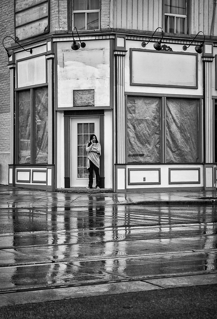Woman and Wet Street || Panasonic GH3/Lumix12-35 | 1/500s | f2.8 | ISO200