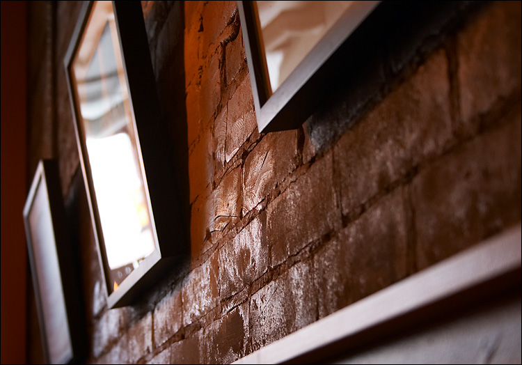 frames and brick wall || canon 300d/ef-s 18-55 | 1/10s | f5.6 | ISO 400 | handheld