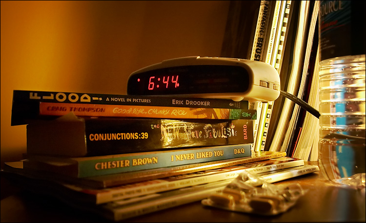 pills, books and clock || canon 300d/ef-s 18-55 | 1/8s | f3.5 | ISO 800 | handheld