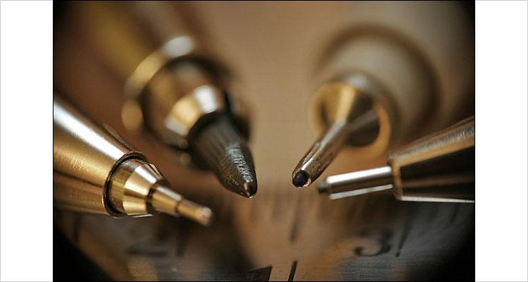 pens and pencils    canon digital rebel   canon 550EX speedlite   2s  F8
